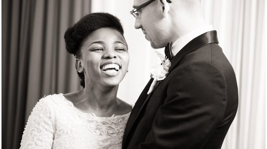 Happy and Jordan laughing at each other on their wedding day at Deeper Life Bible Church at Chicago