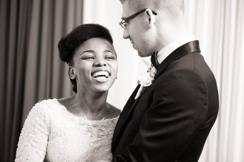 bride is laughing at groom